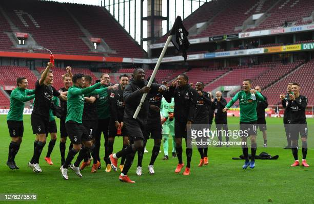 Players of Borussia Monchengladbach celebrate following victory in the Bundesliga match between 1. FC Koeln and Borussia Moenchengladbach at...