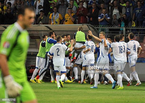 Players of Bosnia and Herzegovina's nationa soccer team celebrate their first goal during the Euro 2016 qualifier match against Cyprus in Zenica on...