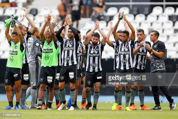 Players of Botafogo acknowledge the fans after a match between Botafogo and Vasco da Gama as part of the Brasileirao Series A championship at...