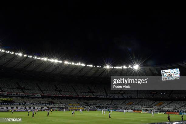 Players of Botafogo and Atletico Mineiro observe a minute of silence for the late Argentine football legend Diego Maradona before the match between...