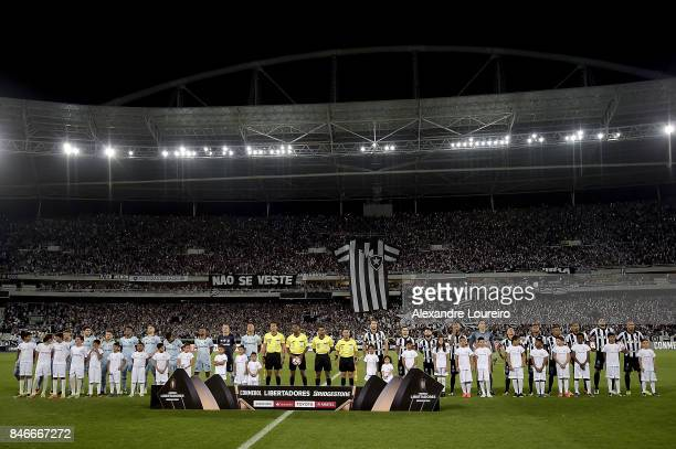 Players of Botafogo and Gremio listen the national anthem before the match between Botafogo and Gremio as part of Copa Bridgestone Libertadores 2017...