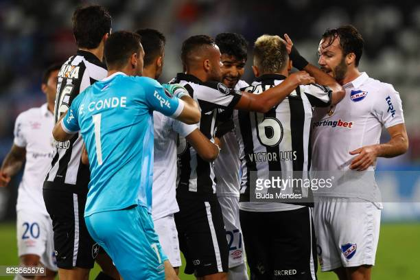 Players of Botafogo and Nacional URU fight during a match between Botafogo and Nacional URU as part of Copa Bridgestone Libertadores 2017 at Nilton...