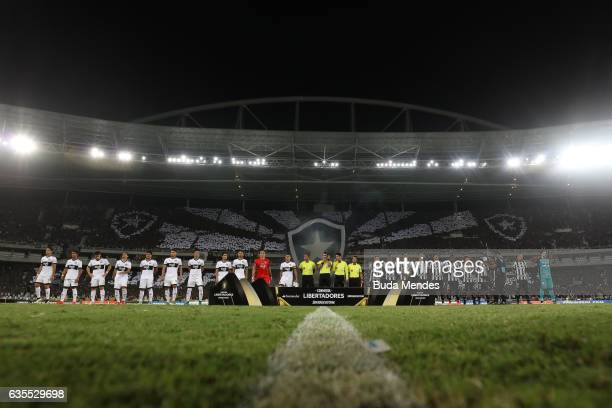 Players of Botafogo and Olimpia enter to the field before a match between Botafogo and Olimpia as part of Copa Bridgestone Libertadores at Engenhao...