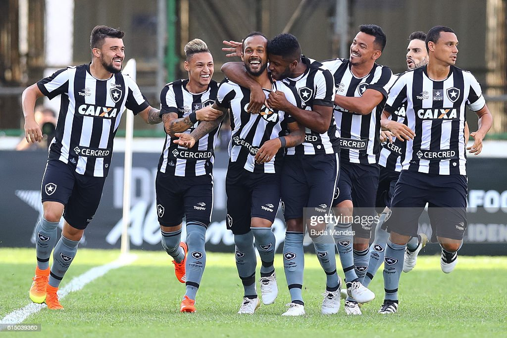 Players of Botafogo celebrate a scored goal against Atletico Mineiro during a match between Botafogo and Atletico Mineiro as part of Brasileirao Series A 2016 at Arena Botafogo on October 16, 2016 in Rio de Janeiro, Brazil.