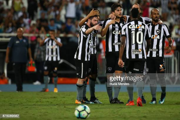 Players of Botafogo celebrate a scored goal during a match between Botafogo and Atletico GO as part of Brasileirao Series A 2017 at Ilha do Urubu...
