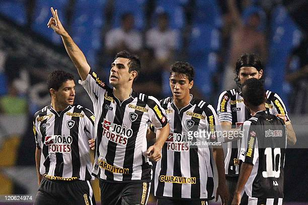 Players of Botafogo celebrate scored goal againist Vasco during a match as part of Serie A 2011 at Engenhao stadium on August 07, 2011 in Rio de...