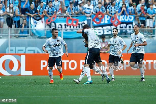 Players of Botafogo celebrate their first goal during the match Gremio v Botafogo as part of Brasileirao Series A 2016 at Arena do Gremio on December...