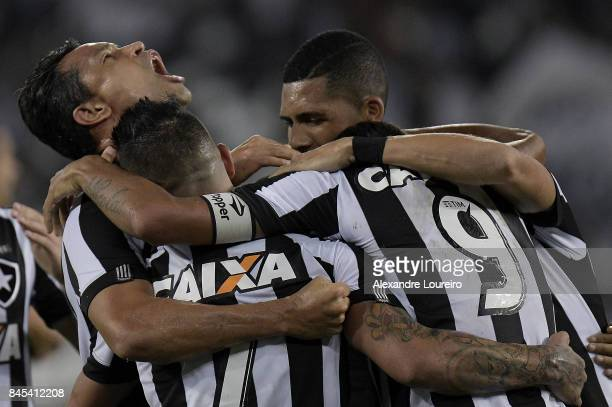 Players of Botafogo celebrates a scored goal during by Roger the match between Botafogo and Flamengo as part of Brasileirao Series A 2017 at Engenhao...