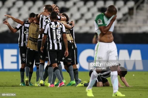 Players of Botafogo celebrates the victory against Atletico Nacional during a match between Botafogo and Atletico Nacional as part of Copa...