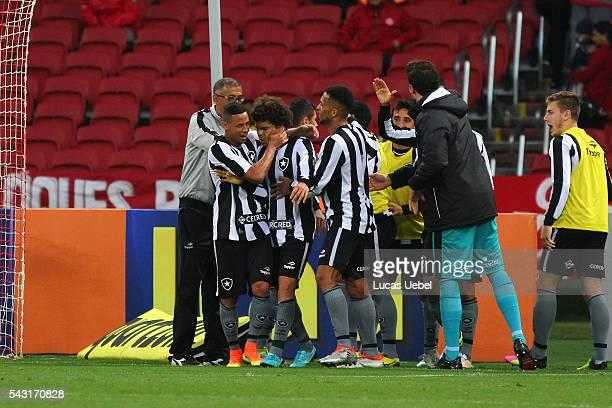 Players of Botafogo celebrates their third goal during the match between Internacional and Botafogo as part of Brasileirao Series A 2016 at Estadio...