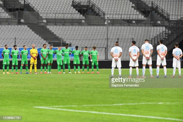 Players of both team repect a minute of silence in tribute of Pape DIOUF and Michel HIDALGO before the French Ligue 1 soccer match between Marseille...