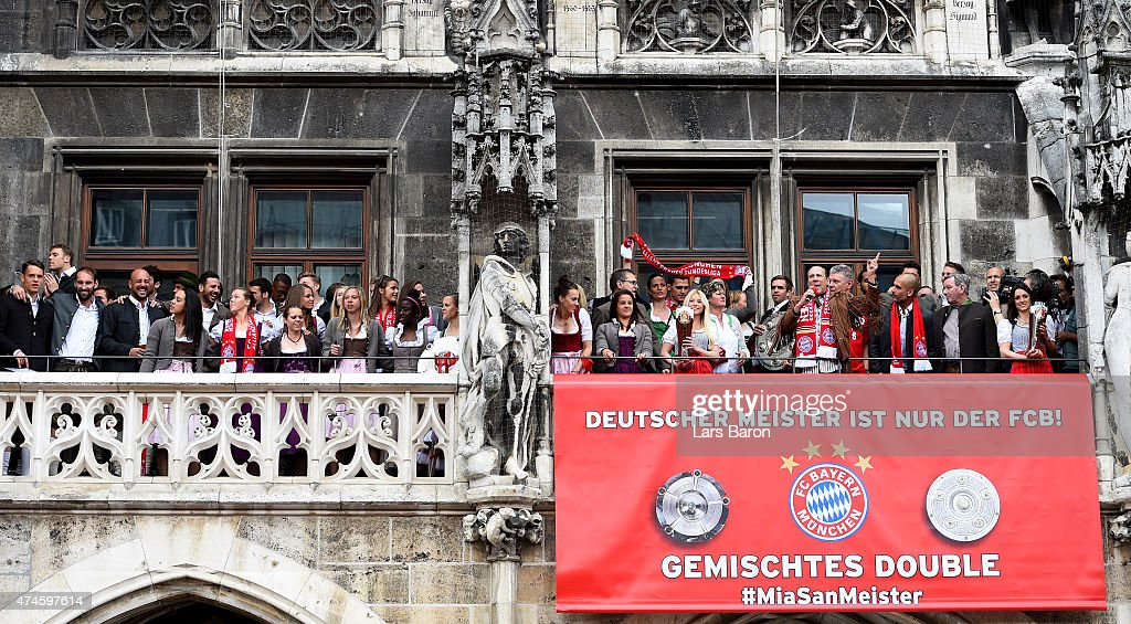 Players of both teams celebrate winning the Bundesliga at Marienplatz on May 24, 2015 in Munich, Germany.
