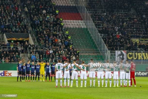 Players of both teams observe the mourning minute for Emiliano Sala during the UEFA Europa League Round of 32 match between SK Rapid Wien and FC...
