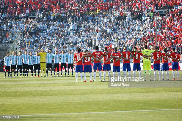 Players of both teams pause for a minutes silence in remembrance of Chilean motorcyclist Carlo De Gavardo prior the 2015 Copa America Chile Final...