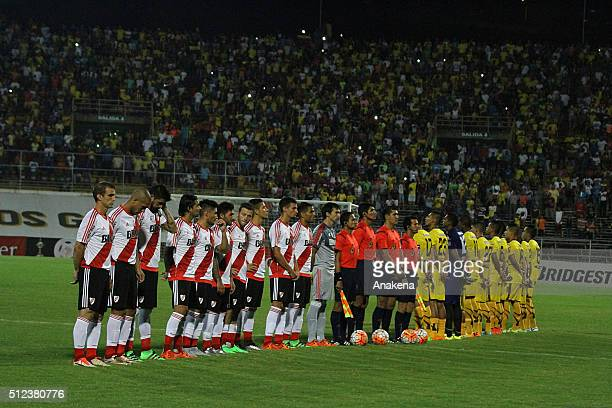 Players of both teams River Plate and Trujillanos sign their national team anthems during a group stage match between Trujillanos and River Plate as...
