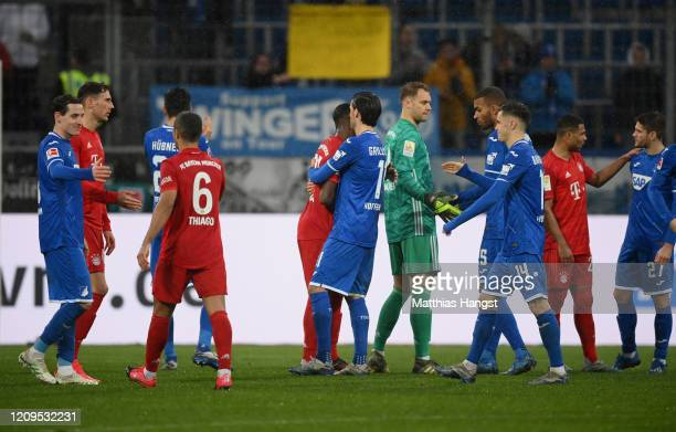 Players of both teams shake hands after the Bundesliga match between TSG 1899 Hoffenheim and FC Bayern Muenchen at PreZero-Arena on February 29, 2020...