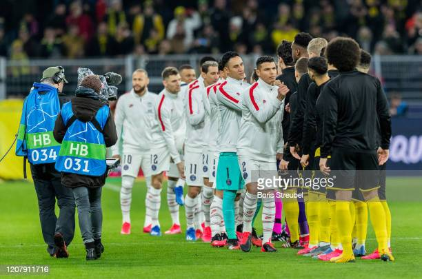 Players of both teams shake hands prior to the UEFA Champions League round of 16 first leg match between Borussia Dortmund and Paris SaintGermain at...