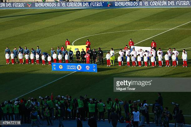 Players of both teams sing their national anthem prior to the 2015 Copa America Chile Final match between Chile and Argentina at Nacional Stadium on...