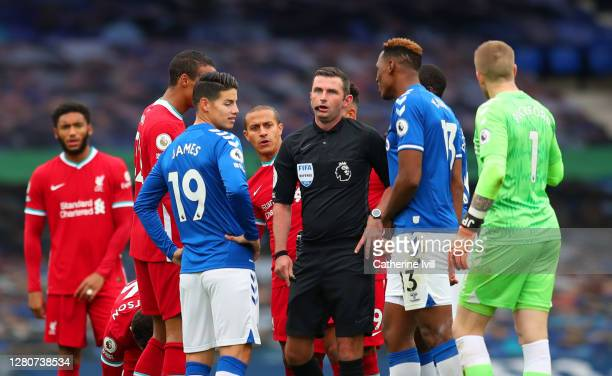 Players of both teams surround Match Referee, Michael Oliver during the Premier League match between Everton and Liverpool at Goodison Park on...