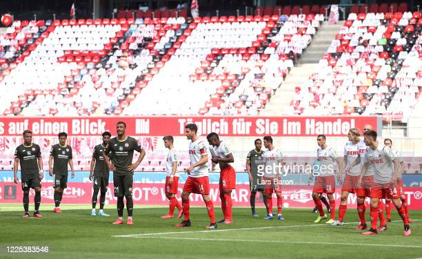 Players of both teams wait for a corner kick during the Bundesliga match between 1. FC Koeln and 1. FSV Mainz 05 at RheinEnergieStadion on May 17,...