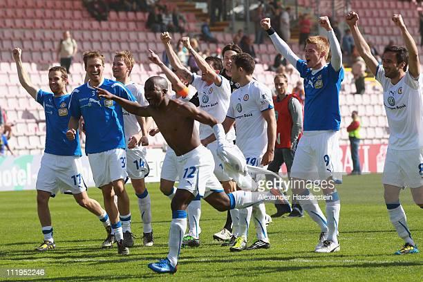 Players of Braunschweig celebrate after the Third League match between SpVgg Unterhaching and Eintracht Braunschweig at Generali Arena on April 10...