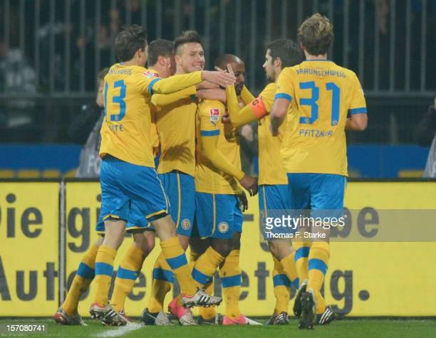 Players of Braunschweig celebrate their teams first goal scored by Domi Kumbela during the Second Bundesliga match between Eintracht Braunschweig and...
