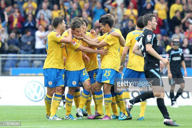 Players of Braunschweig celebrate their teams second goal during the Second Bundesliga match between Eintracht Braunschweig and TSV 1860 Muenchen at...