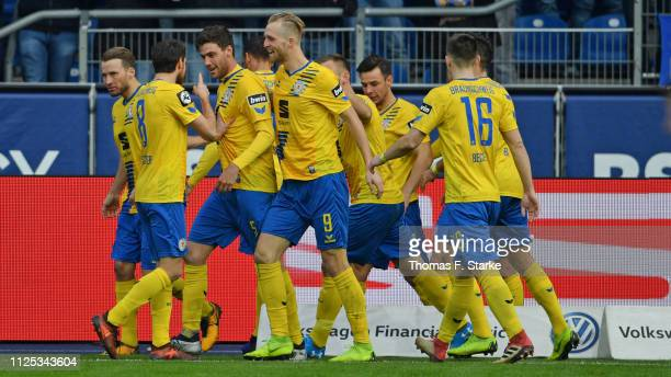 Players of Braunschweig celebrate with Benjamin Kessel who scored his teams first goal during the 3 Liga match between Eintracht Braunschweig and FC...