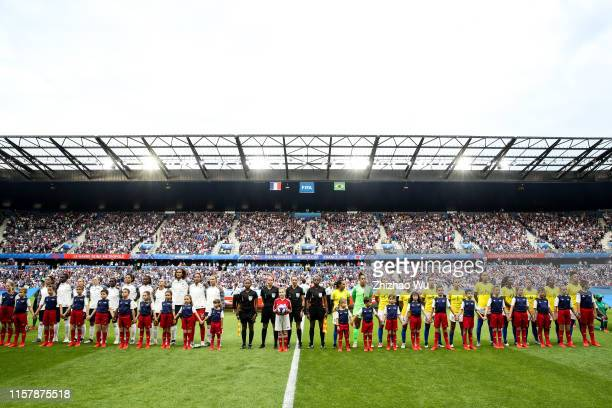 Players of Brazil and France line up for team photos prior to the 2019 FIFA Women's World Cup France Round Of 16 match between France and Brazil at...