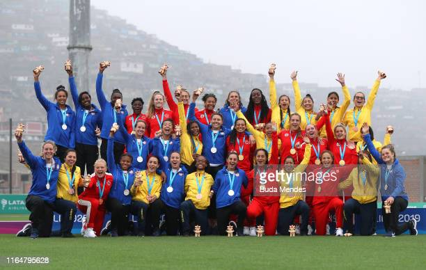 Players of Brazil Canada and The United States pose for pictures in the podium of women´s rugby sevns at Rugby Field of Complejo Deportivo Villa...