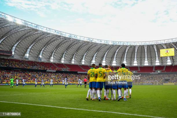 Players of Brazil celebrate a scored goal during the International Friendly Match between Brazil and Honduras at Beira Rio Stadium on June 9, 2019 in...