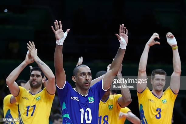 Players of Brazil celebrate a victory during the men's qualifying volleyball match between the Brazil and Canada on Day 4 of the Rio 2016 Olympic...