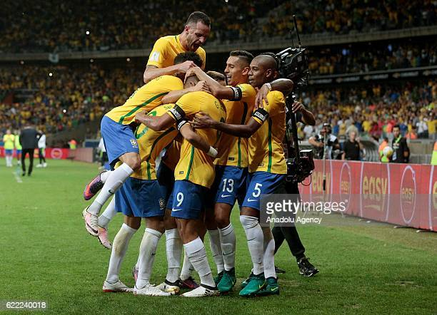 Players of Brazil celebrate after scoring a goal during the FIFA 2018 World Cup Qualifier match between Brazil and Argentina at Mineirao Stadium in...