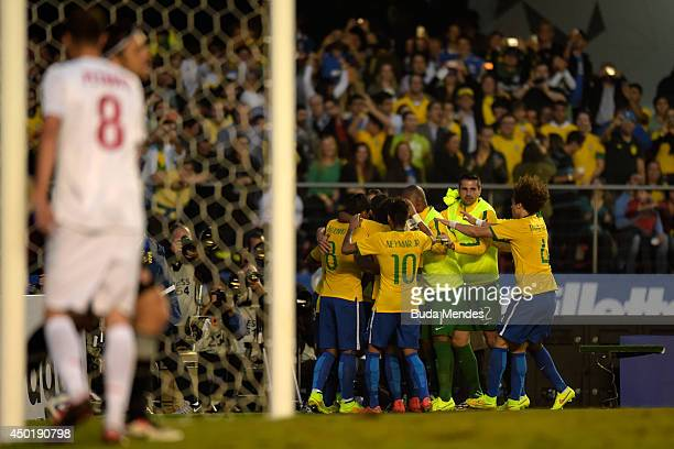 Players of Brazil celebrate after scoring a goal during the International Friendly Match between Brazil and Serbia at Morumbi Stadium on June 06 2014...