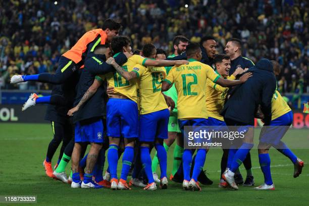 Players of Brazil celebrate after winning in the penalty shootout the Copa America Brazil 2019 quarterfinal match between Brazil and Paraguay at...