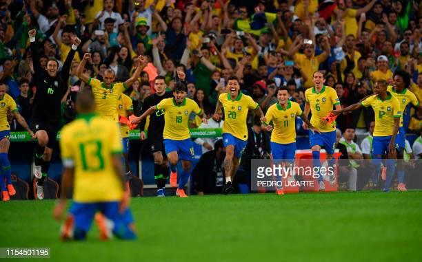 Players of Brazil celebrate after winning the Copa America after defeating Peru 3-1 in the final match of the football tournament at Maracana Stadium...