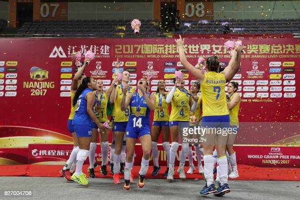 Players of Brazil celebrate and dance with trophy after winning the final match between Brazil and Italy during 2017 Nanjing FIVB World Grand Prix...