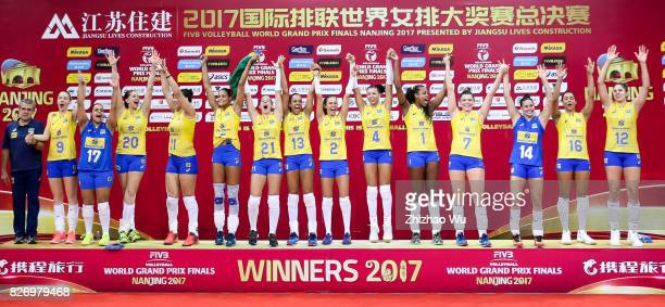 Players of Brazil celebrate during the award ceremony 2017 Nanjing FIVB World Grand Prix Finals between Italy and Brazil on August 6 2017 in Nanjing...