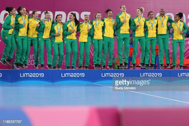 Players of Brazil celebrate in the podium after winning gold in Women's Handball Gold at Villa Deportiva Nacional - VIDENA on Day 4 of Lima 2019 Pan...