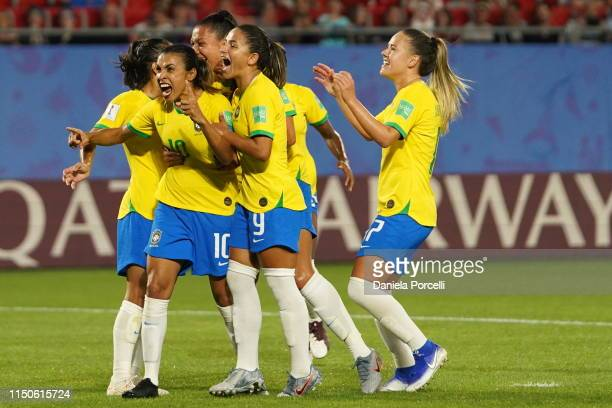 Players of Brazil celebrate Marta's goal during the 2019 FIFA Women's World Cup France group C match between Italy and Brazil at Stade du Hainaut on...