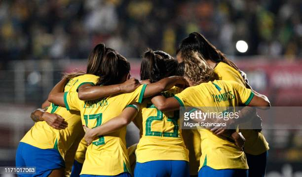 Players of Brazil celebrate the third goal of their team scored by Debinha during a match between Argentina and Brazil part of Uber International Cup...