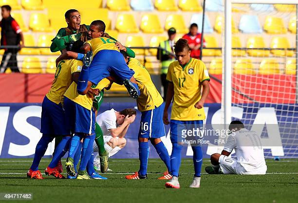 Players of Brazil celebrate victory after the FIFA U17 Men's World Cup 2015 round of 16 match between Brazil and New Zealand at Estadio Sausalito on...