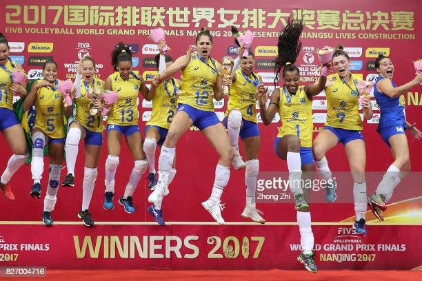 Players of Brazil celebrate winning with trophy after winning the final match between Brazil and Italy during 2017 Nanjing FIVB World Grand Prix...