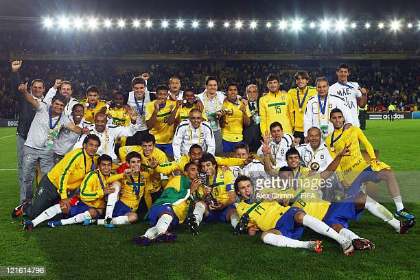 Players of Brazil celebrate with the trophy after winning FIFA U20 World Cup 2011 final against Portugal at Estadio Nemesio Camacho 'El Campin' on...