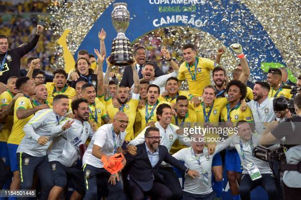 Players of Brazil celebrate with the trophy after winning the Copa America after defeating Peru in the final match of the football tournament at...