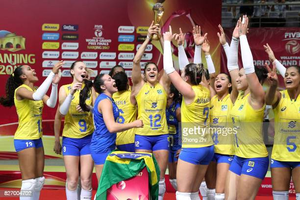 Players of Brazil celebrate with trophy after winning the final match between Brazil and Italy during 2017 Nanjing FIVB World Grand Prix Finals on...