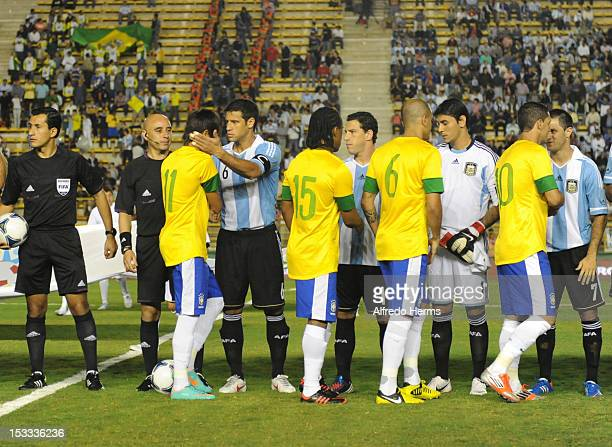 Players of Brazil greet players of Argentina prior the second leg of the Superclasico de las Americas between Argentina and Brazil at Centenario...