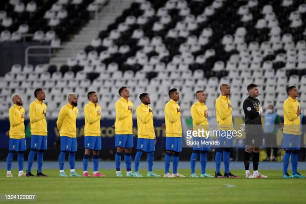 Players of Brazil line up for the national anthem prior to a match between Brazil and Peru as part of Group B of Copa America Brazil 2021 at Estadio...