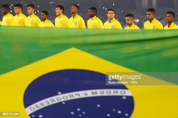 Players of Brazil line up for the National Anthems ahead the FIFA U17 World Cup India 2017 Quarter Final match between Germany and Brazil at...
