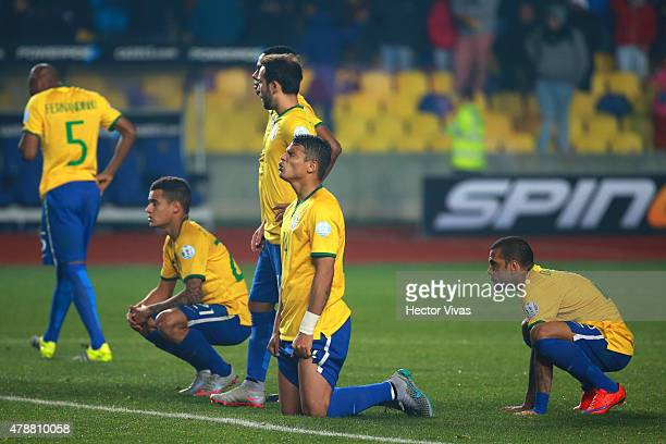 Players of Brazil look dejected after the 2015 Copa America Chile quarter final match between Brazil and Paraguay at Ester Roa Rebolledo Stadium on...